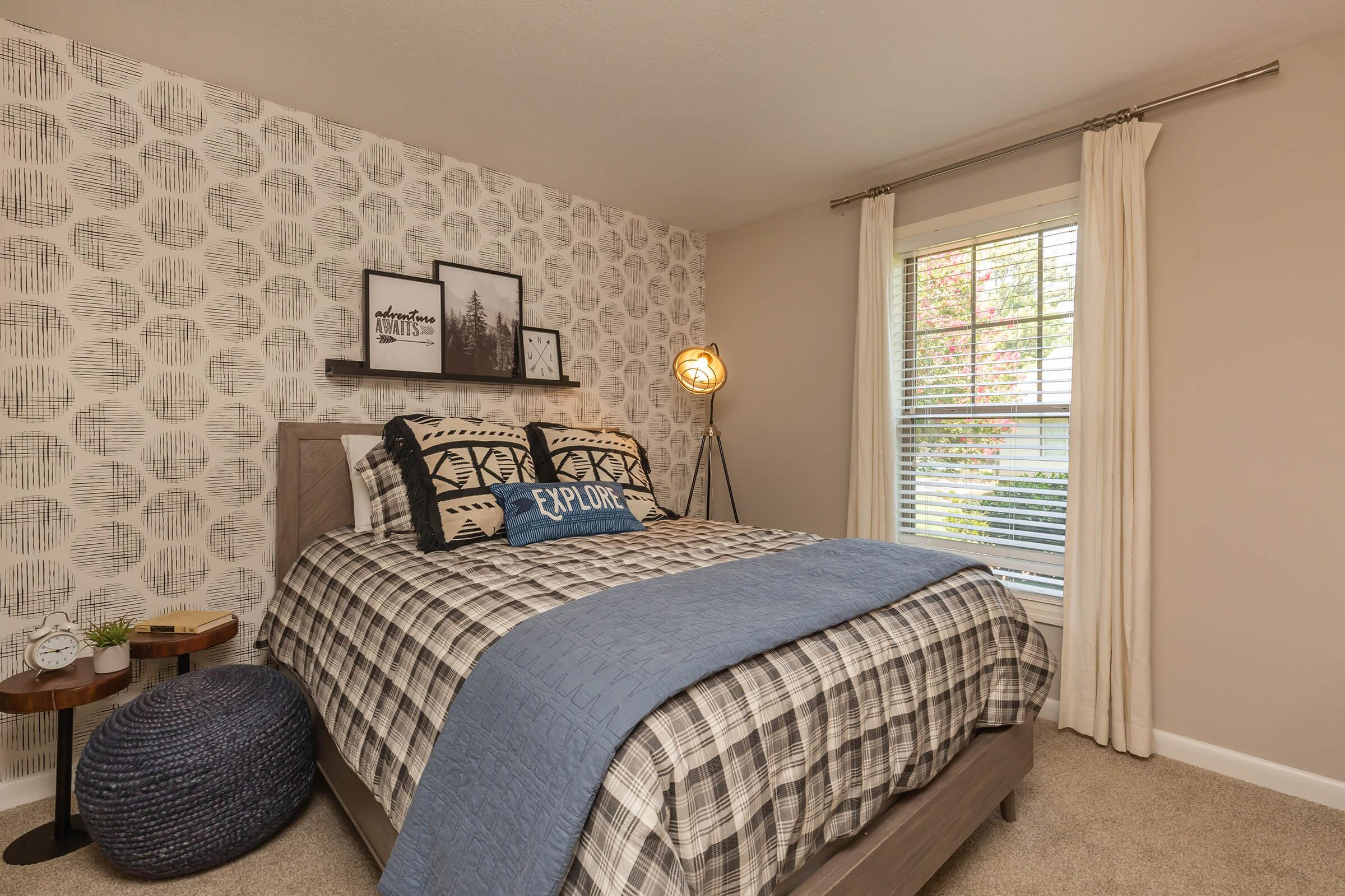 a bedroom with a large bed sitting in a room
