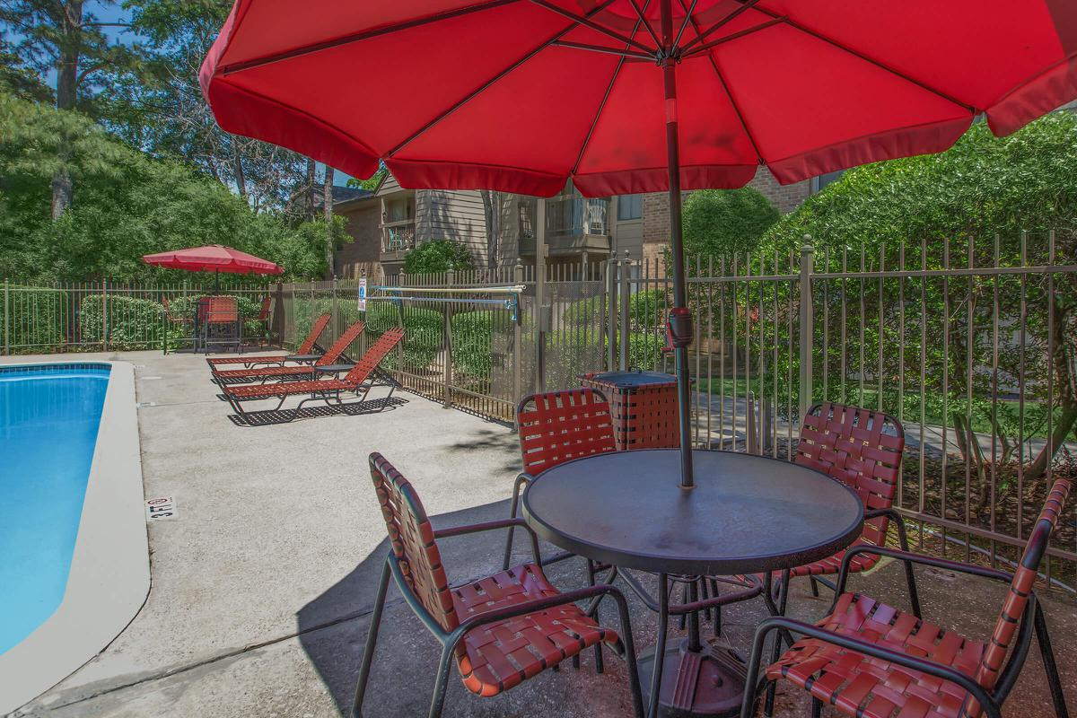 a table with a red umbrella