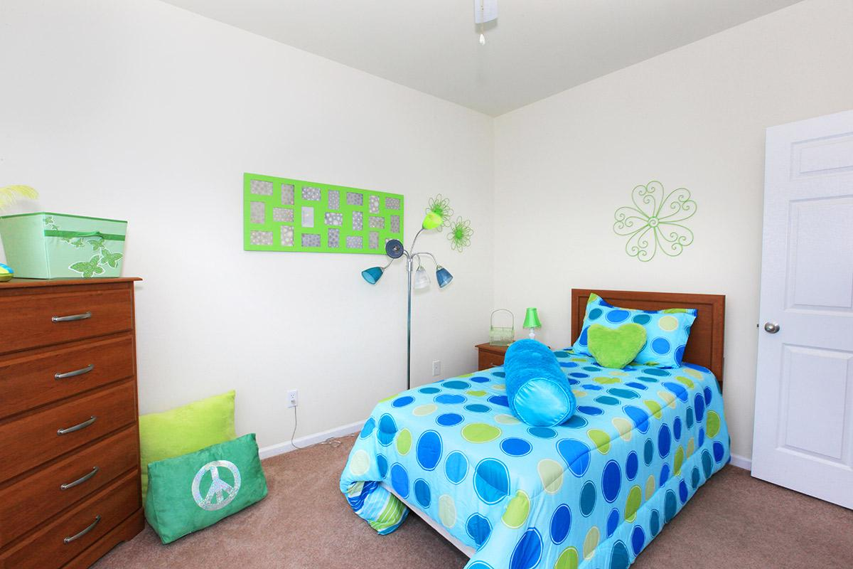 a bedroom with a green door in a room