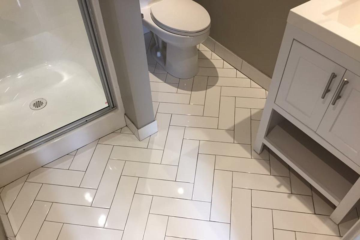 a close up of a white tiled floor