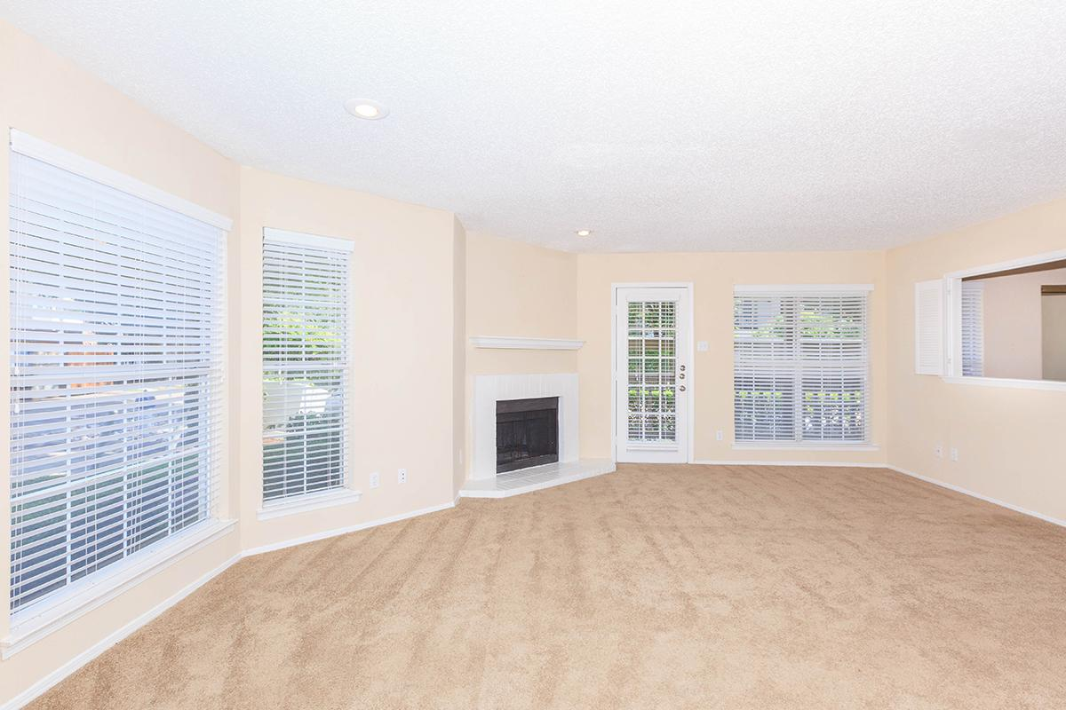 a room filled with furniture and a large window