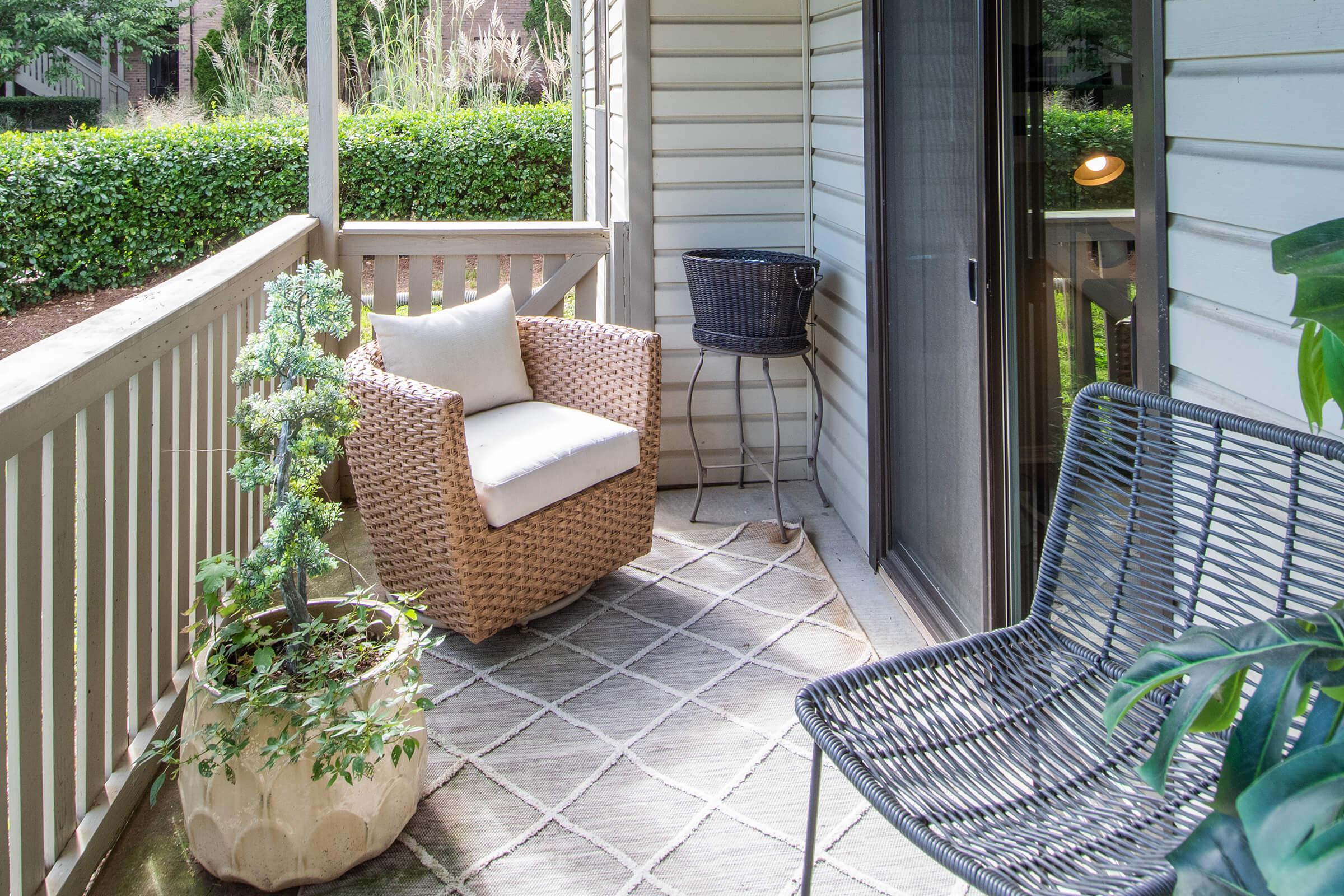 a green chair in a garden
