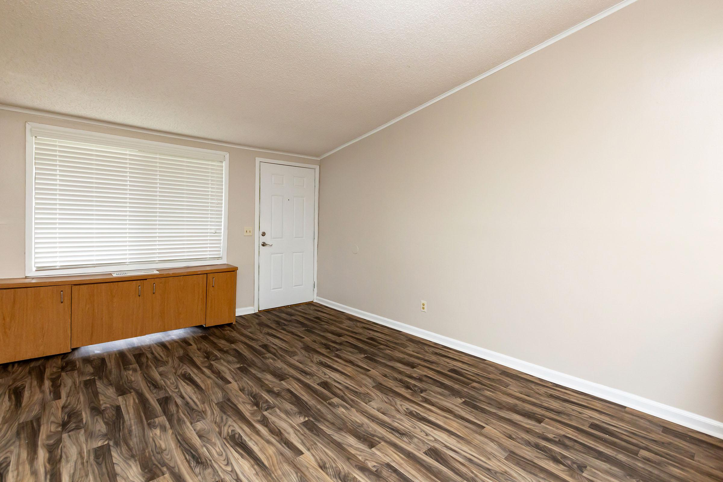 a bedroom with a wooden floor