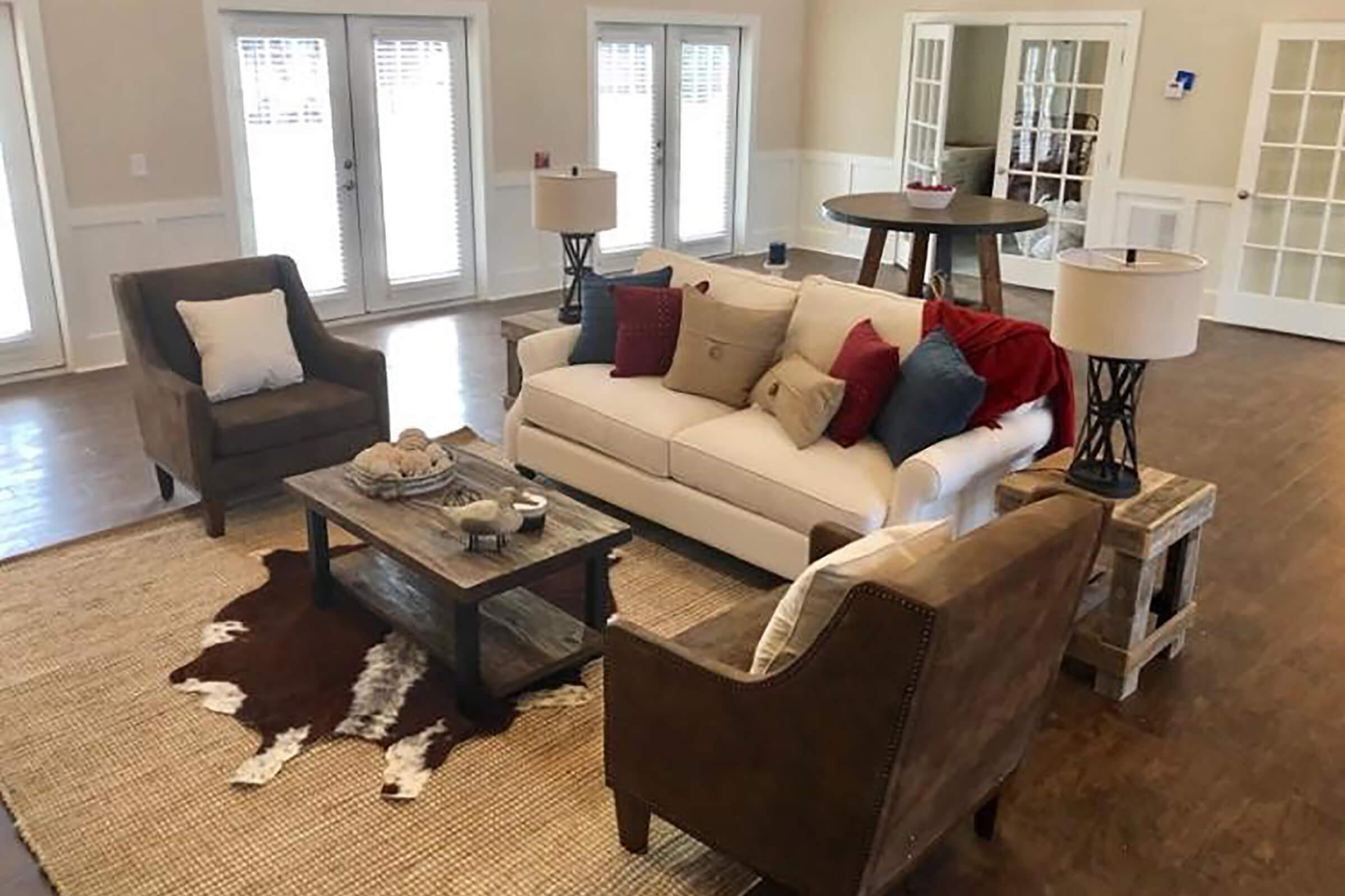 a living room filled with furniture and a window