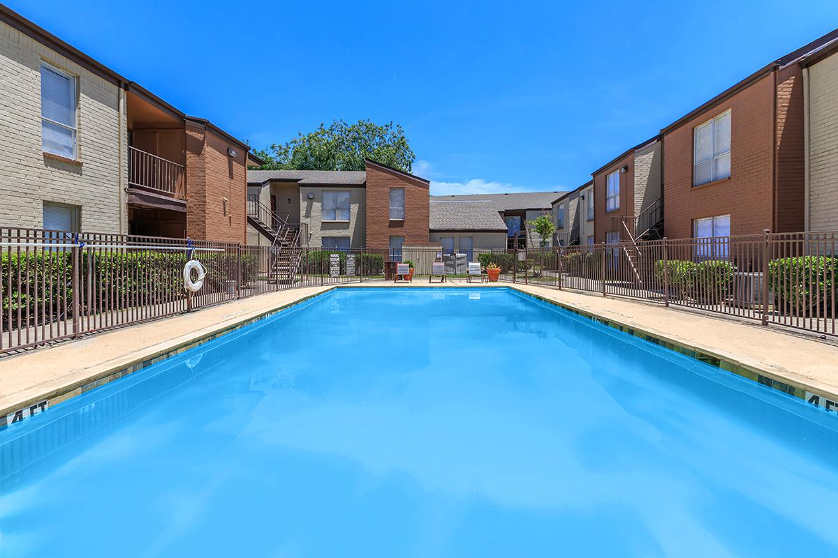 a pool next to a brick building