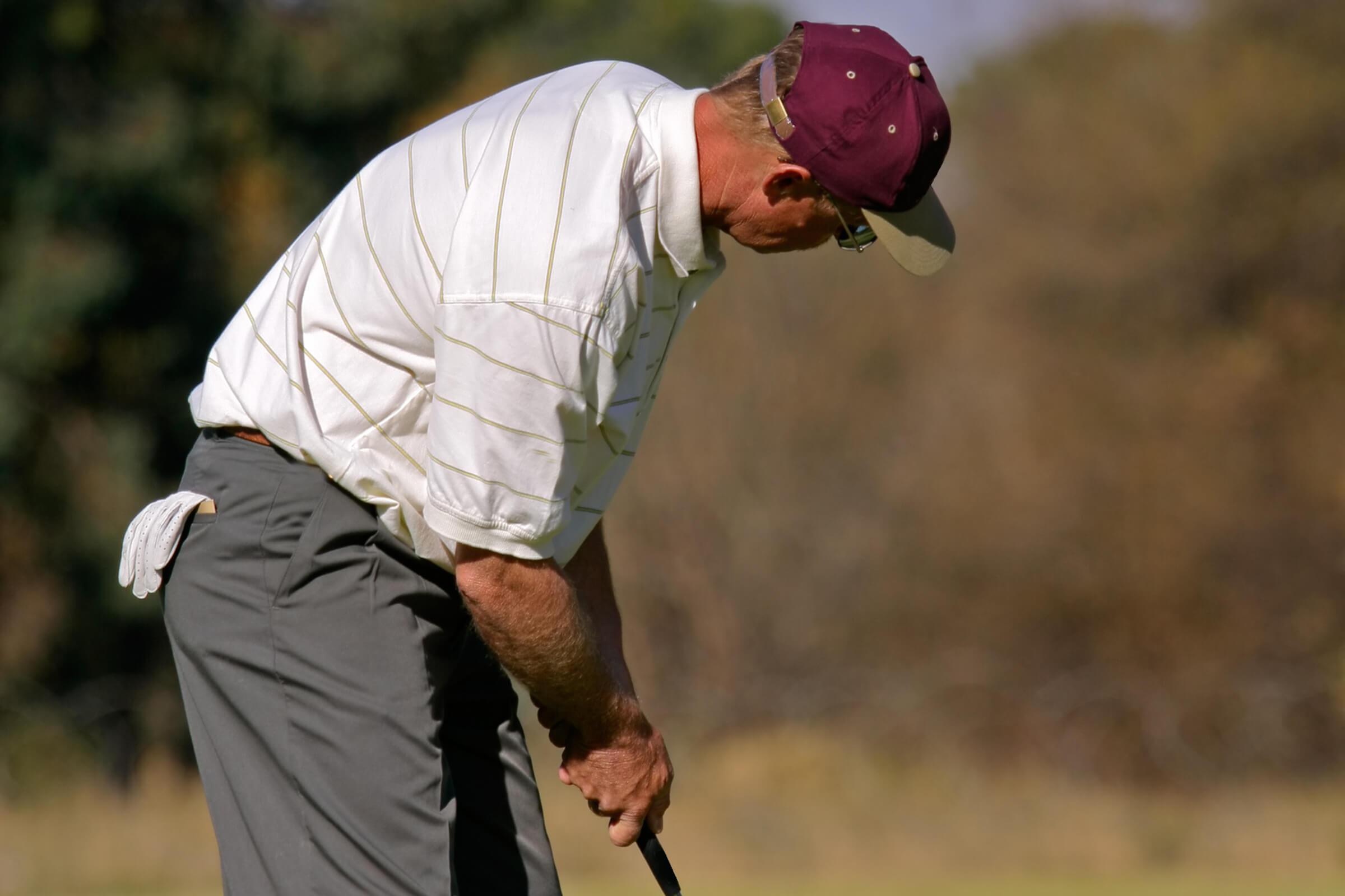a man wearing a golf ball