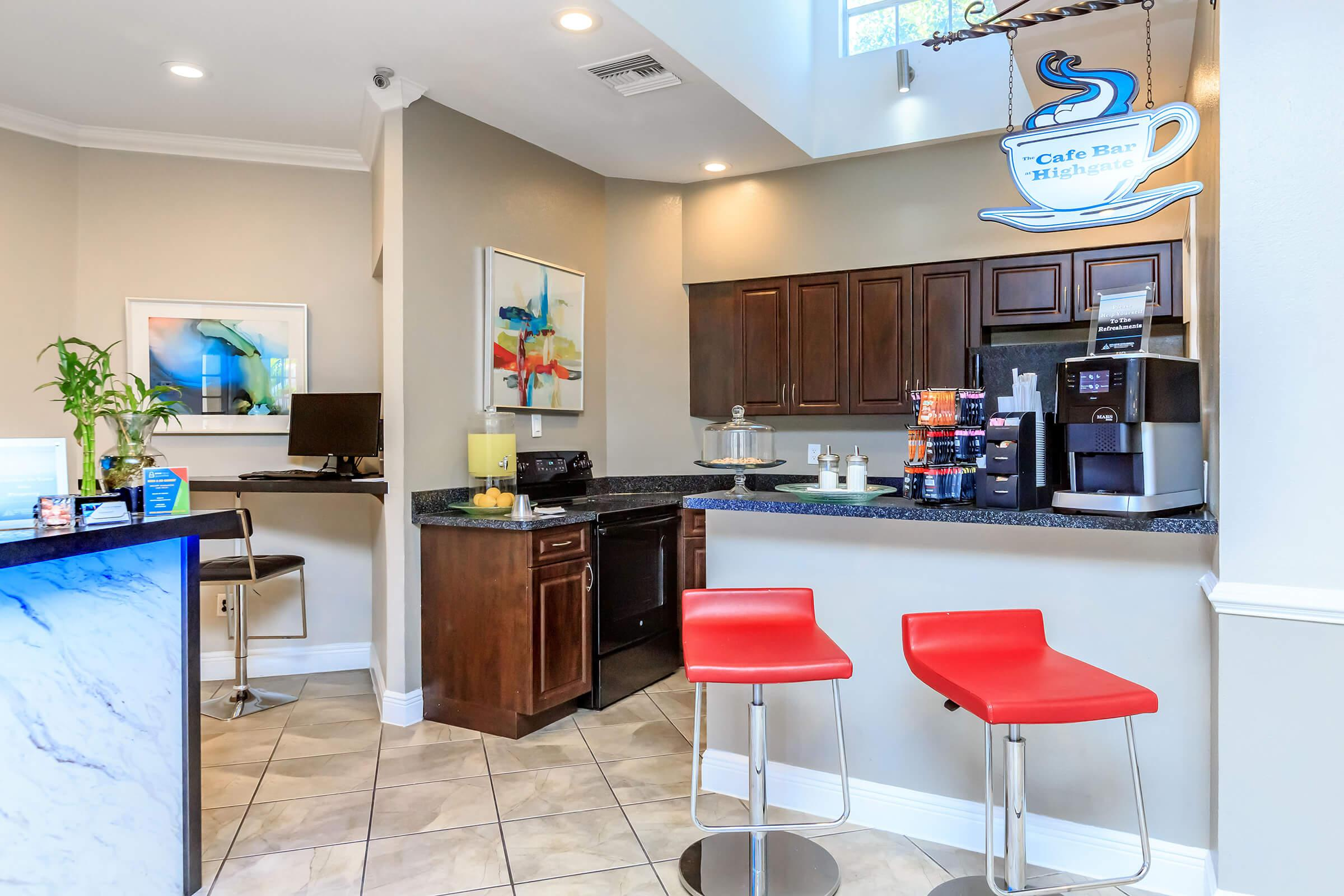 a kitchen with a red chair in a room