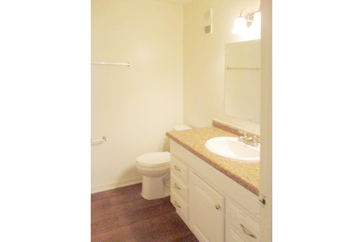 a small white sink in a bathroom