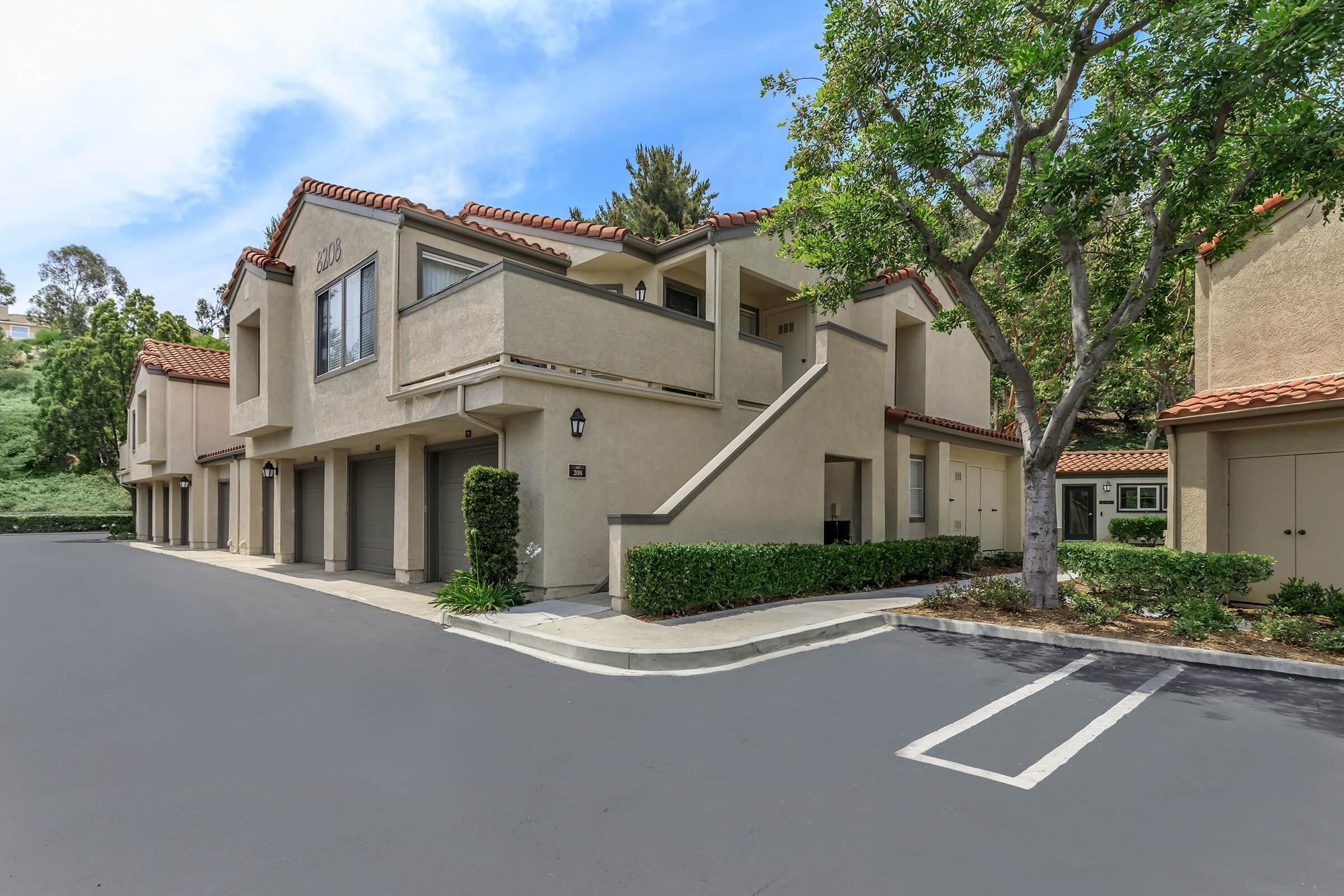Sycamore Canyon Apartments community building with attached garages