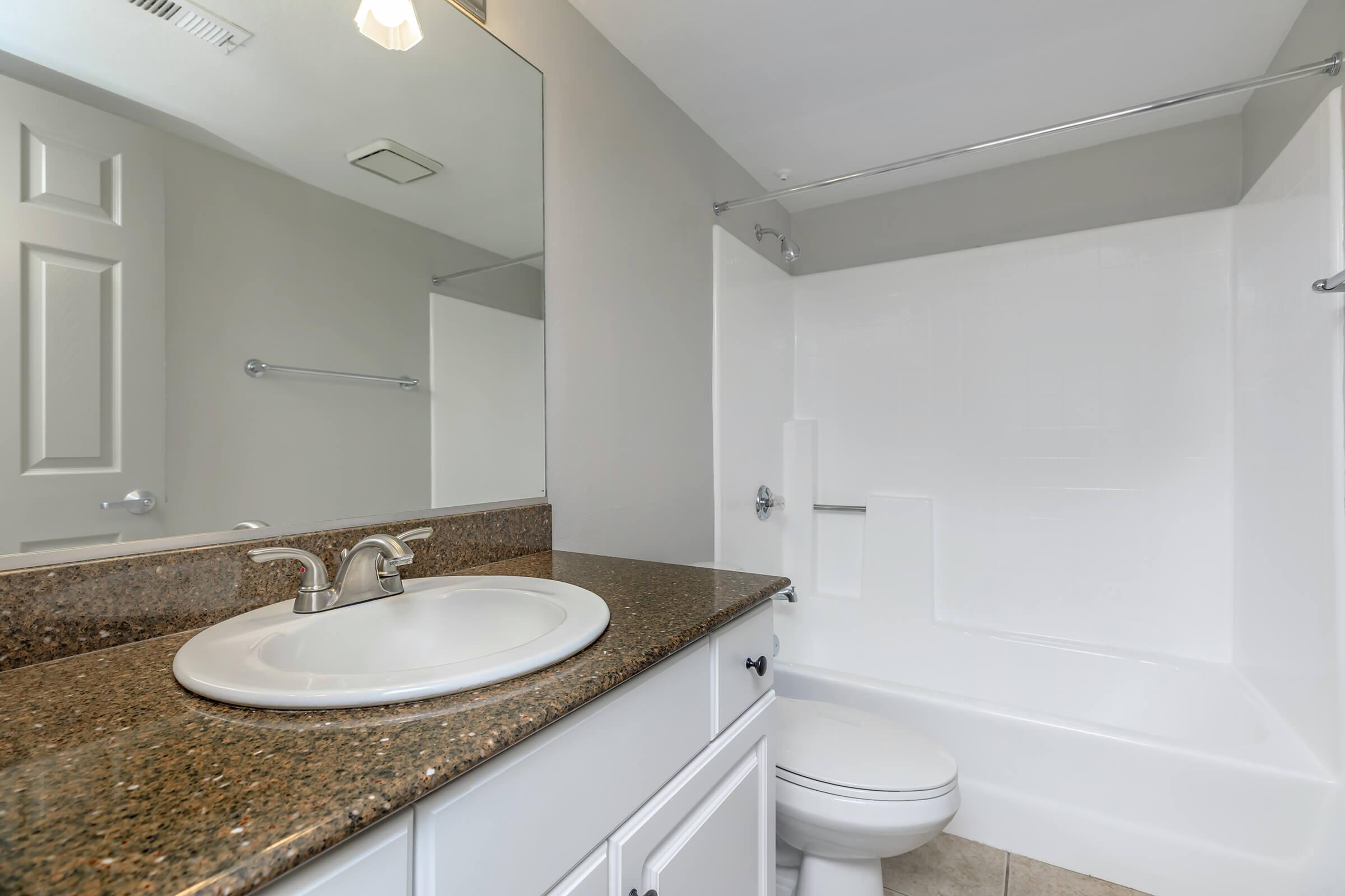 Bathroom with brown countertops