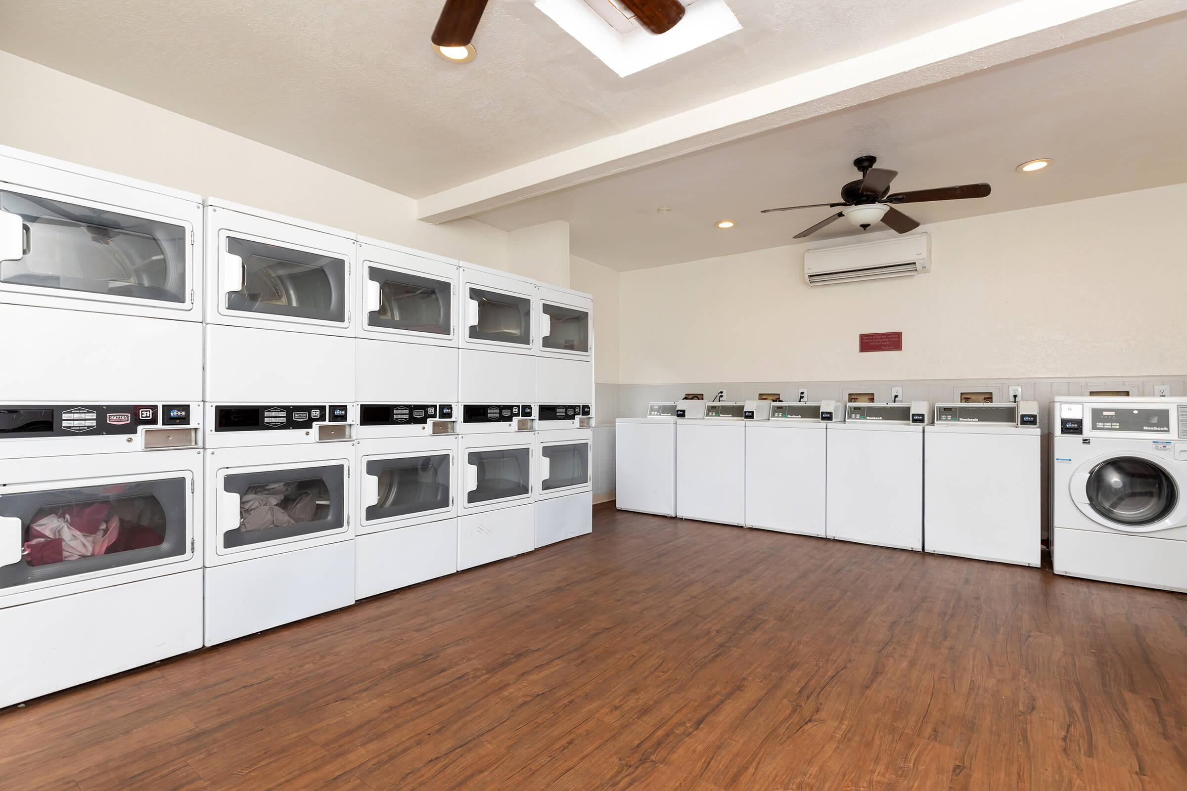 a large kitchen with white cabinets