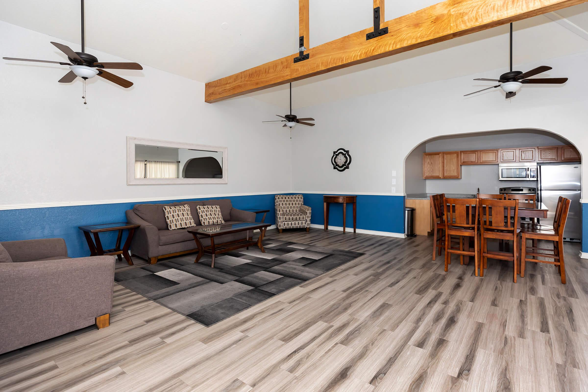 a living area with wooden wheels in a room