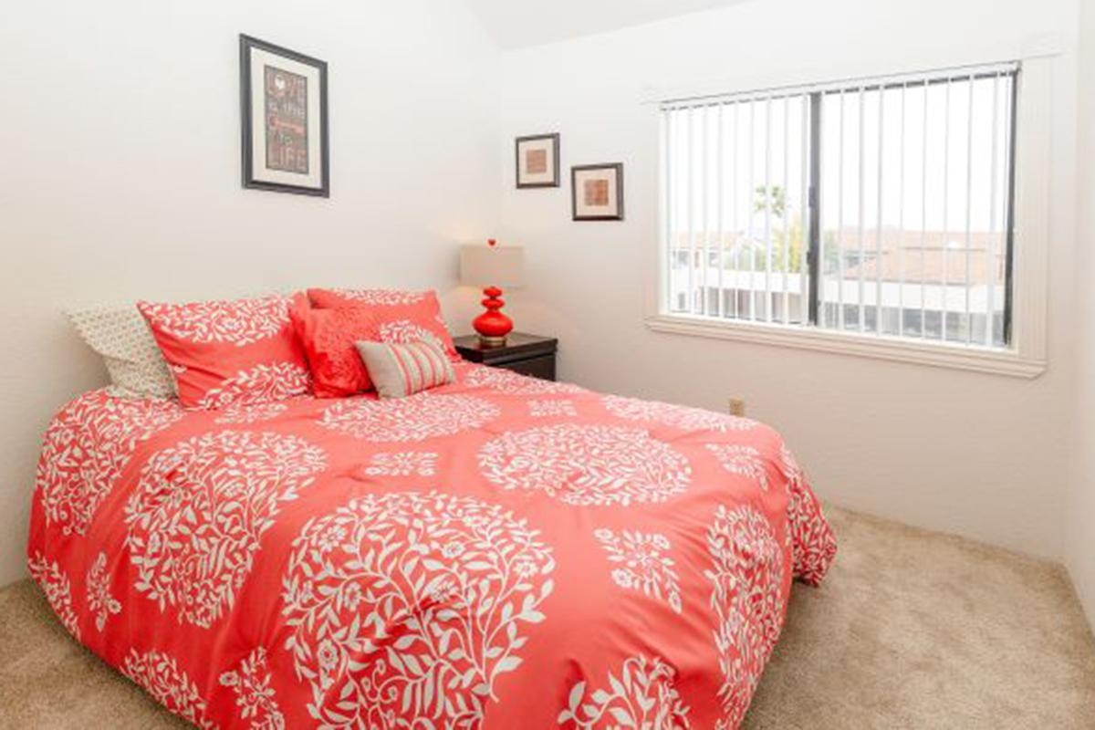 a red and white bed in a room