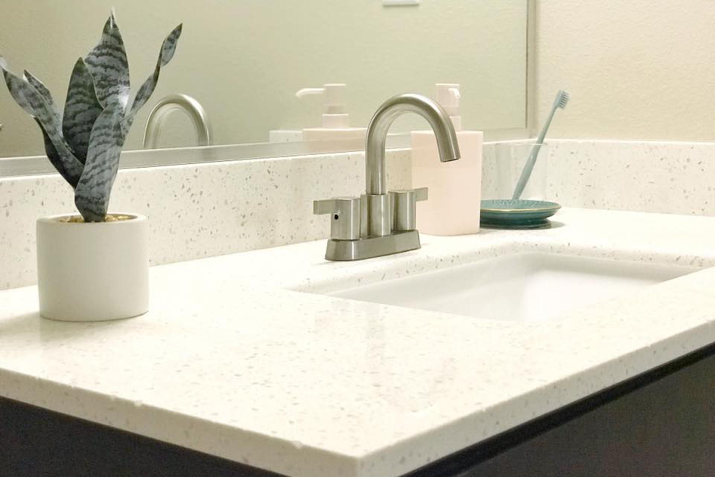 a white sink sitting next to a counter