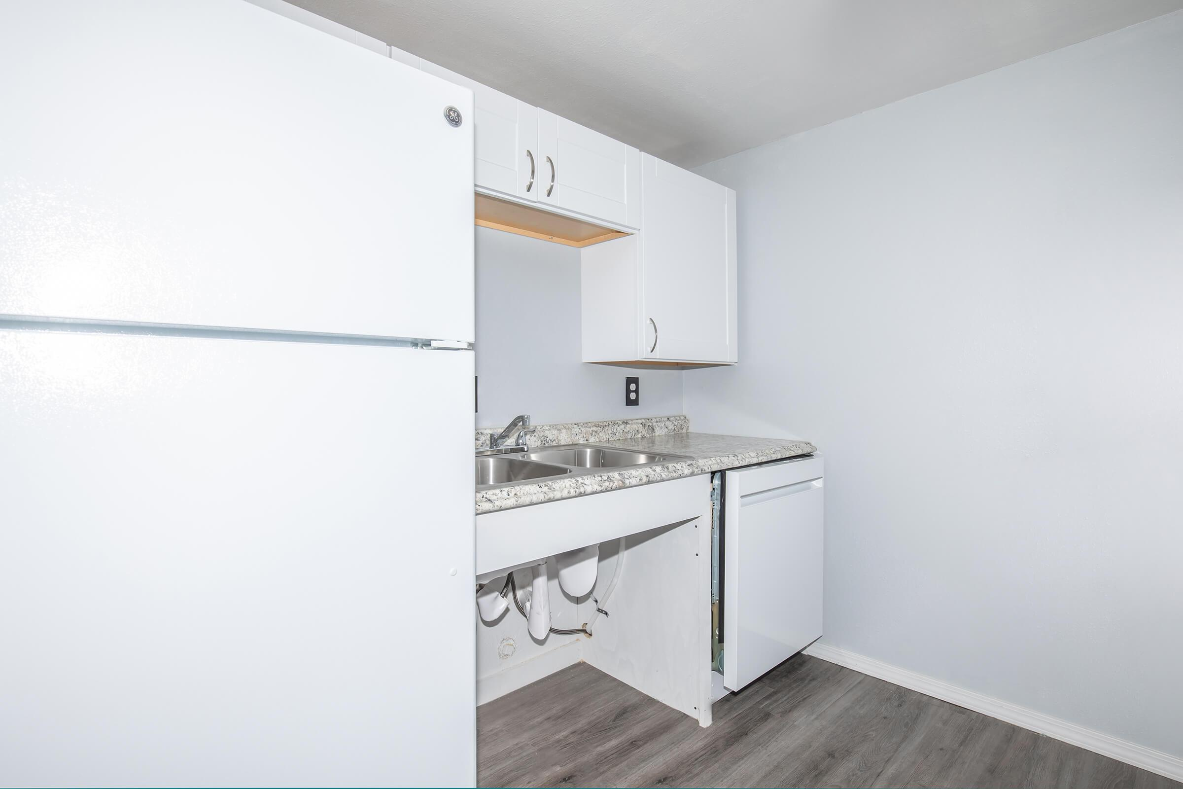 a large white refrigerator in a kitchen