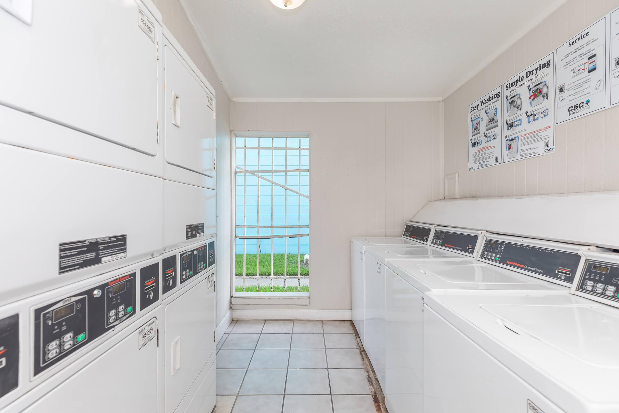 a kitchen with a stove and a microwave