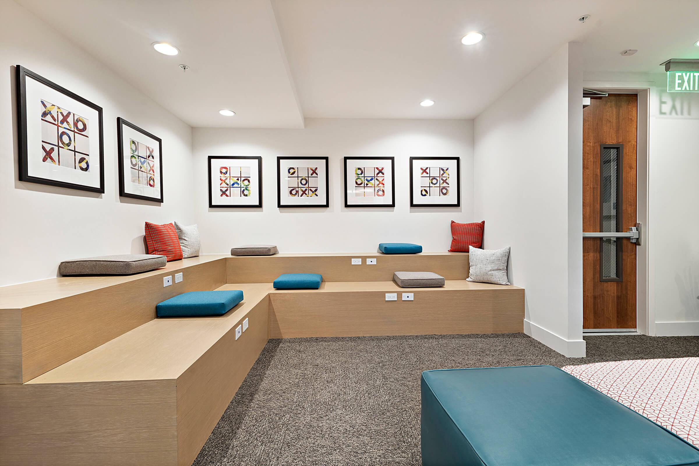 Wooden bench with cushions in Calligraphy Urban Residences community room