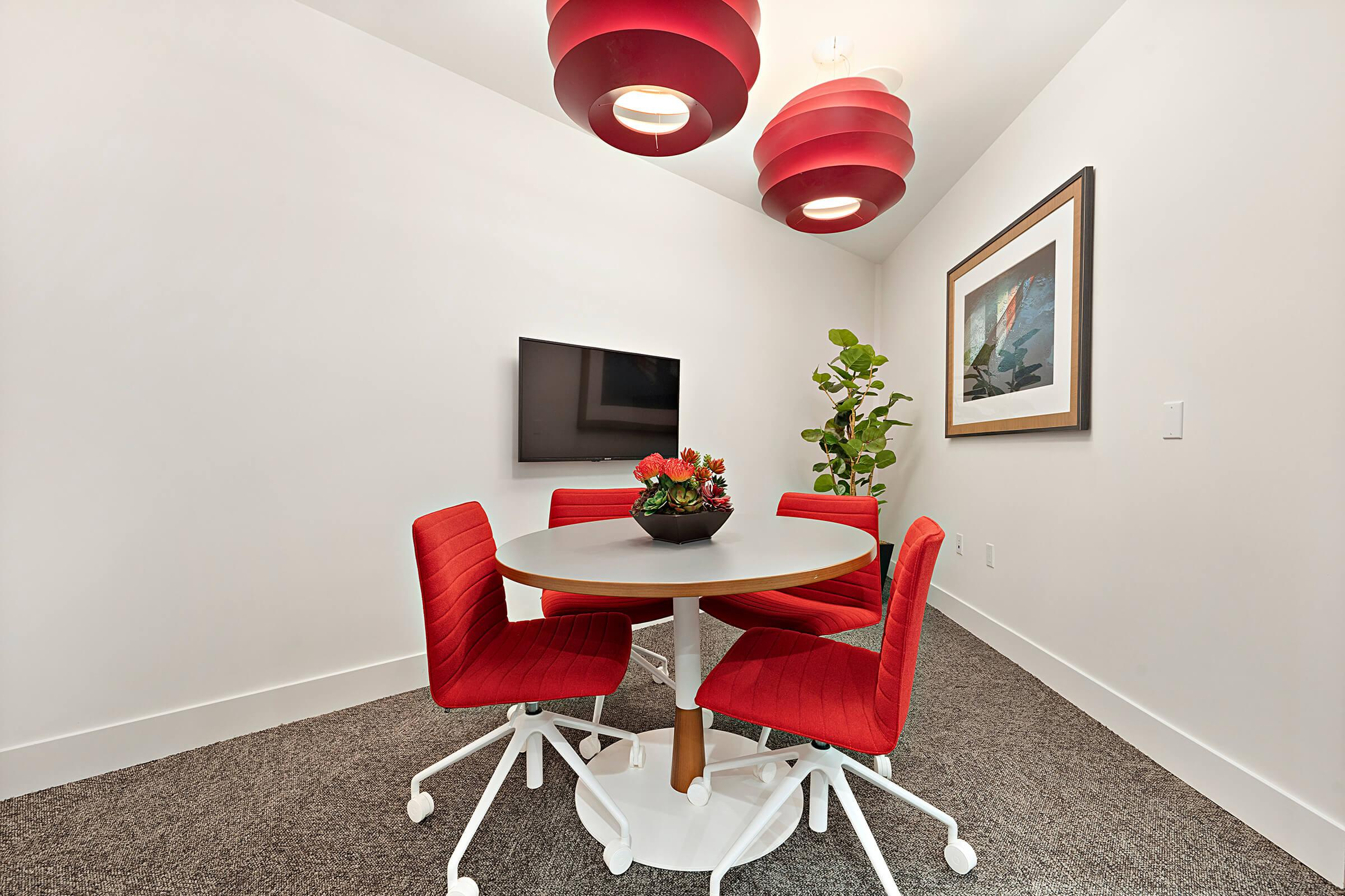 Calligraphy Urban Residences conference room with a table and chairs