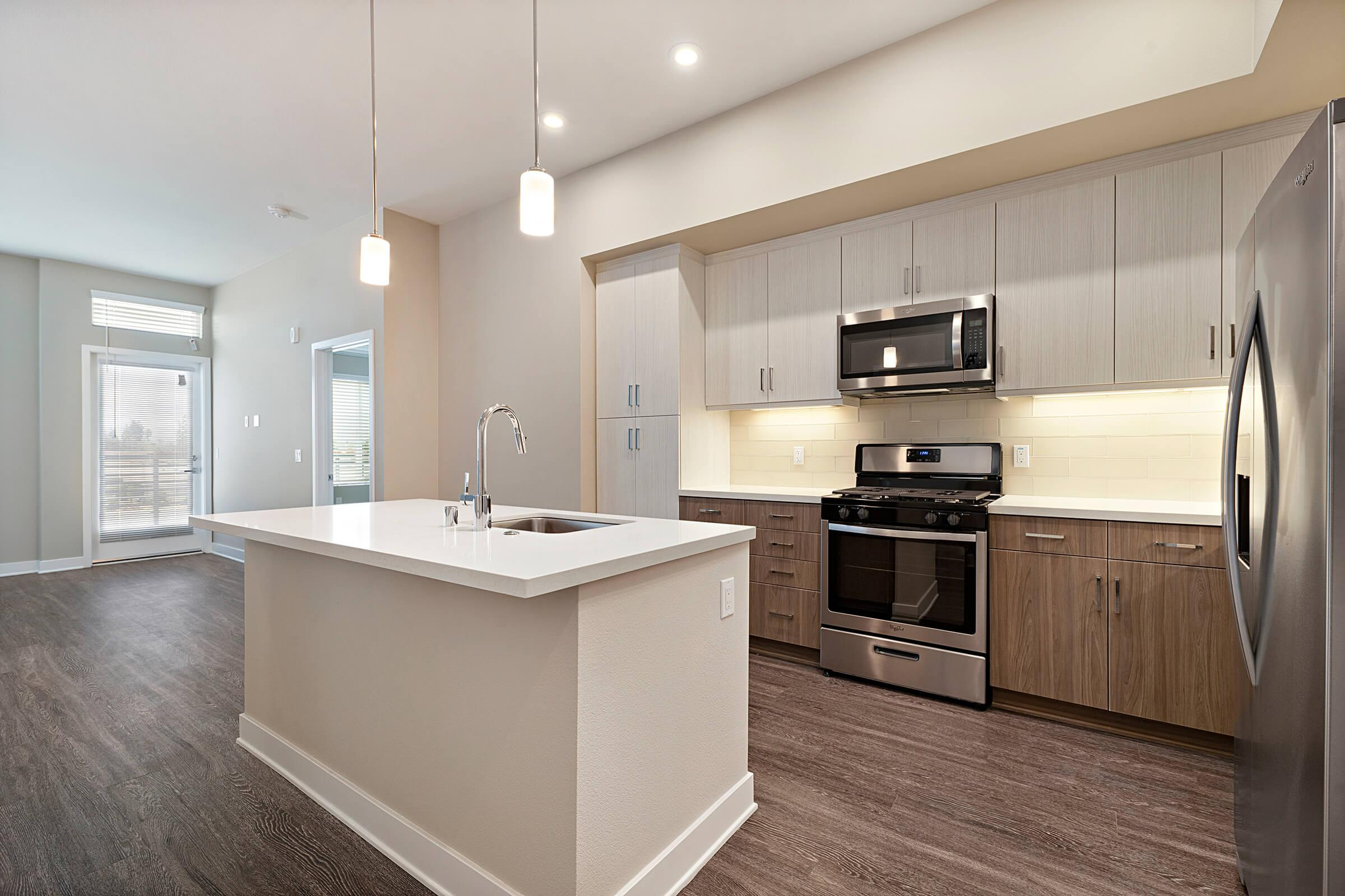 Kitchen with stainless steel appliances and an island