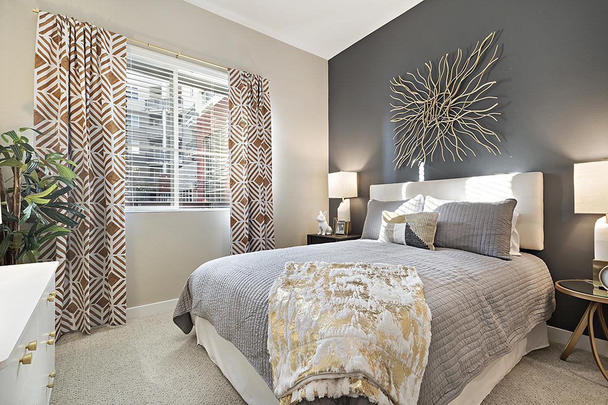 Bedroom with gray bedding