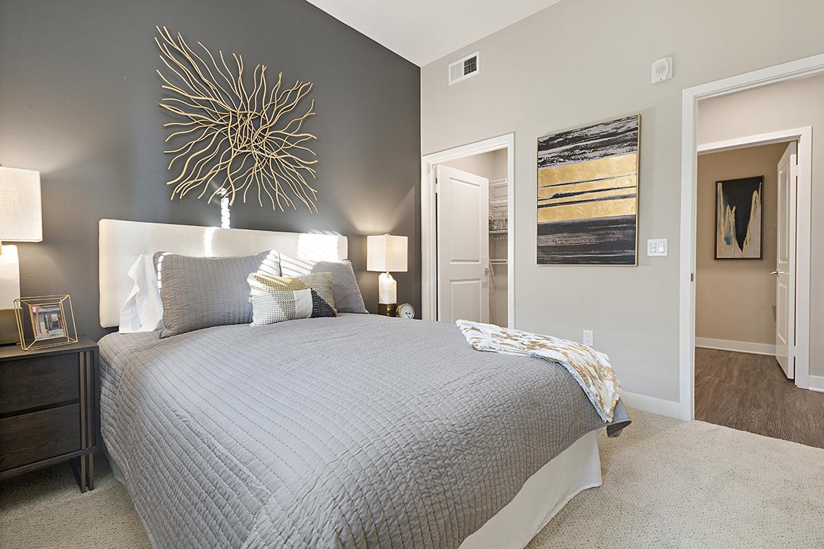 Bedroom with open closet door