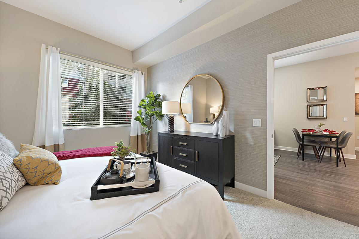 Bedroom with open door to dining room