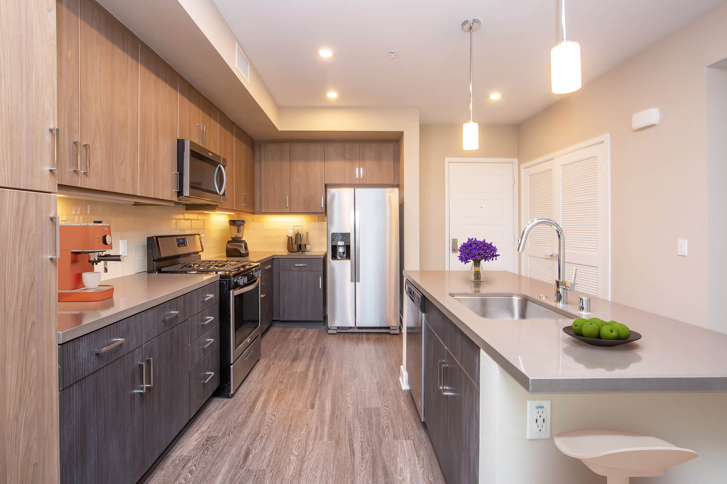 Kitchen with stainless steel appliance and wooden cabinets