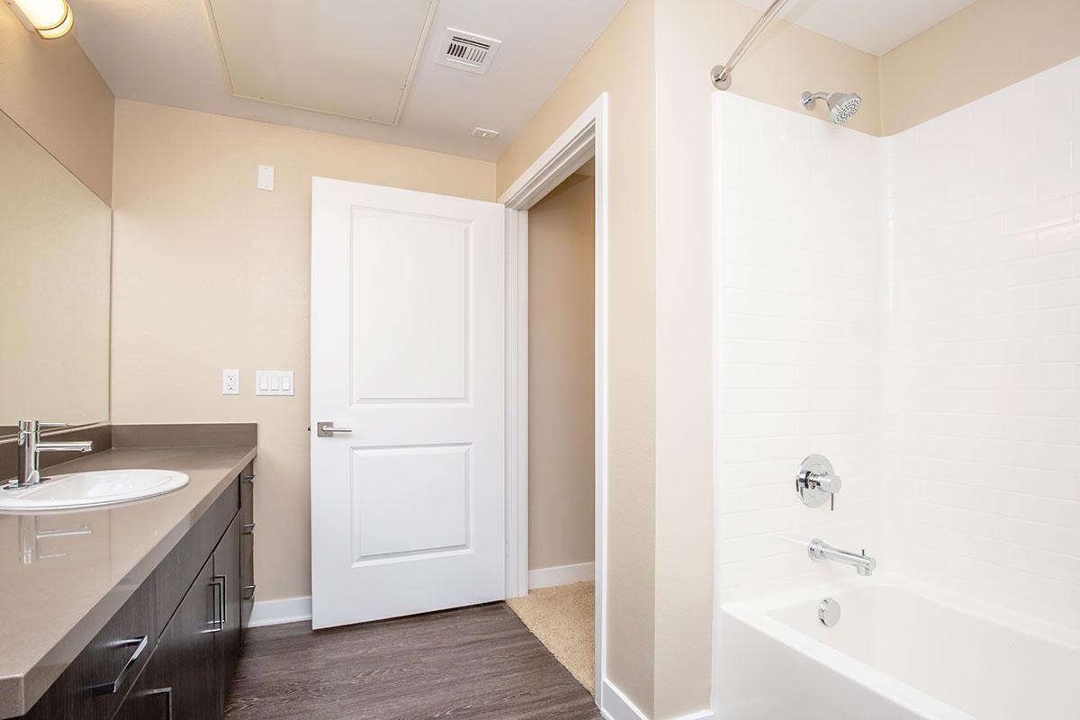 Unfurnished bathroom shower and sink