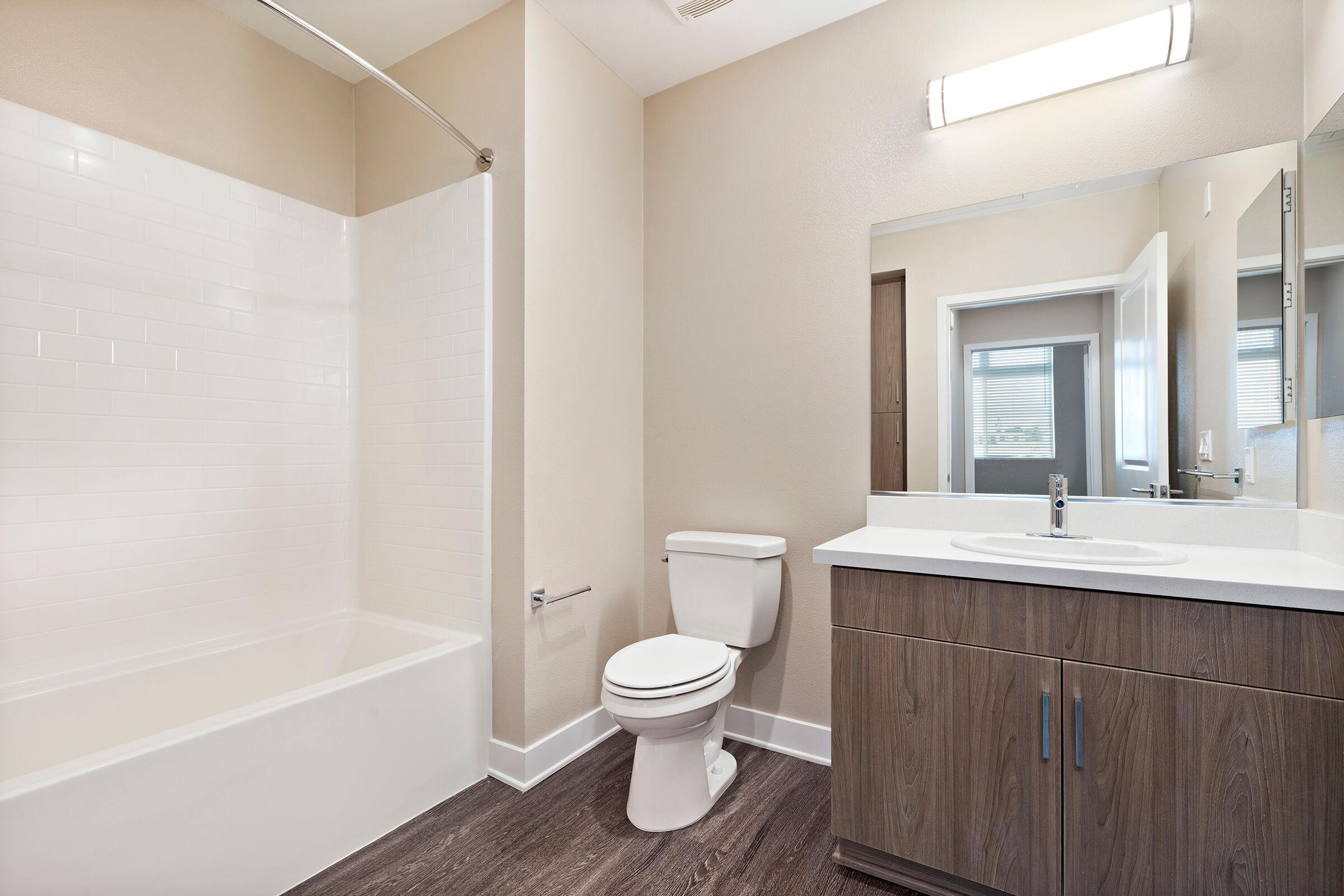 Unfurnished bathroom with wooden cabinets