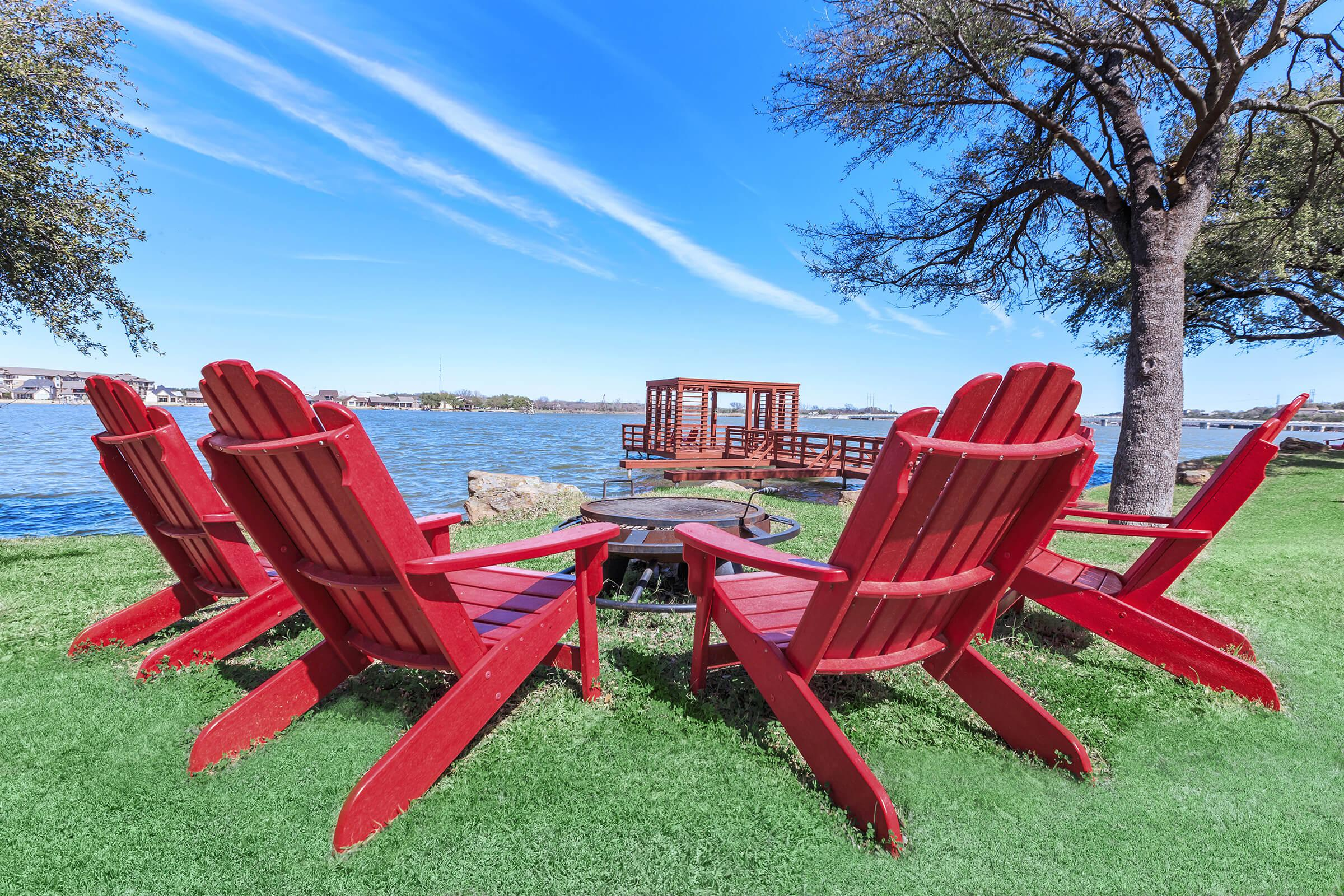a group of lawn chairs sitting on top of a picnic table