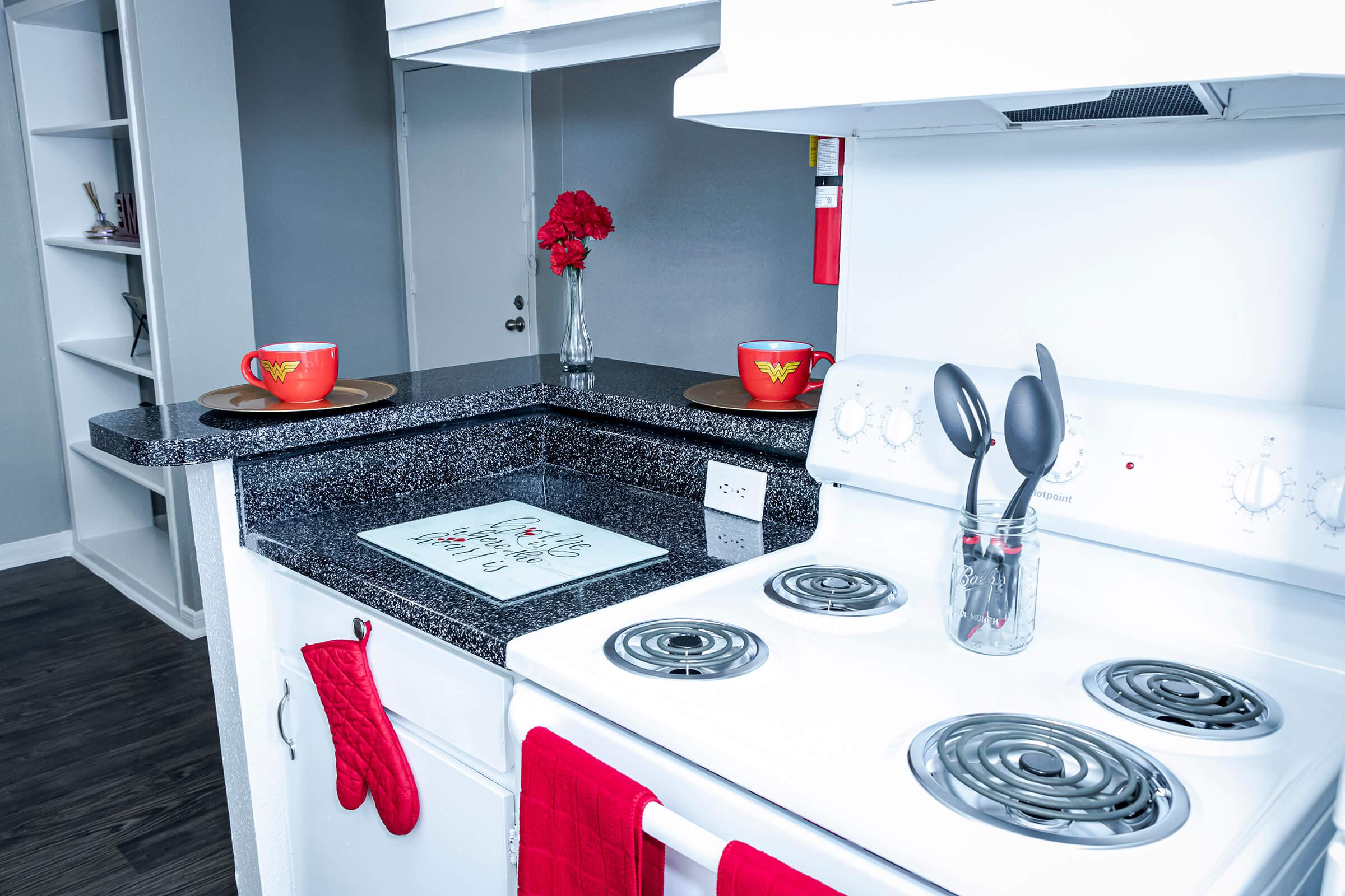 a red and white kitchen