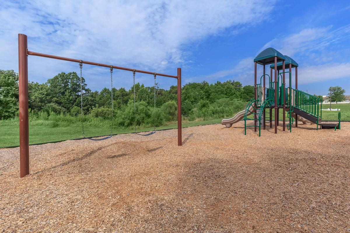 a playground in a dirt field