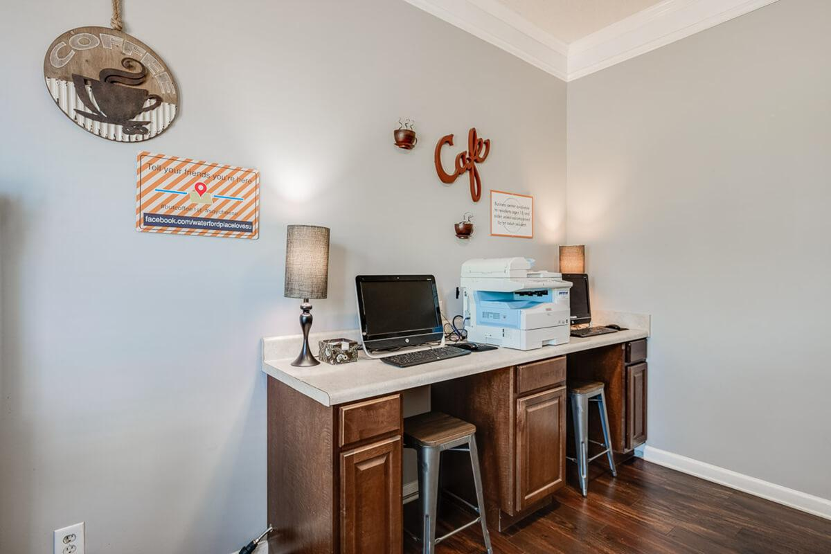a desk with a laptop in a room
