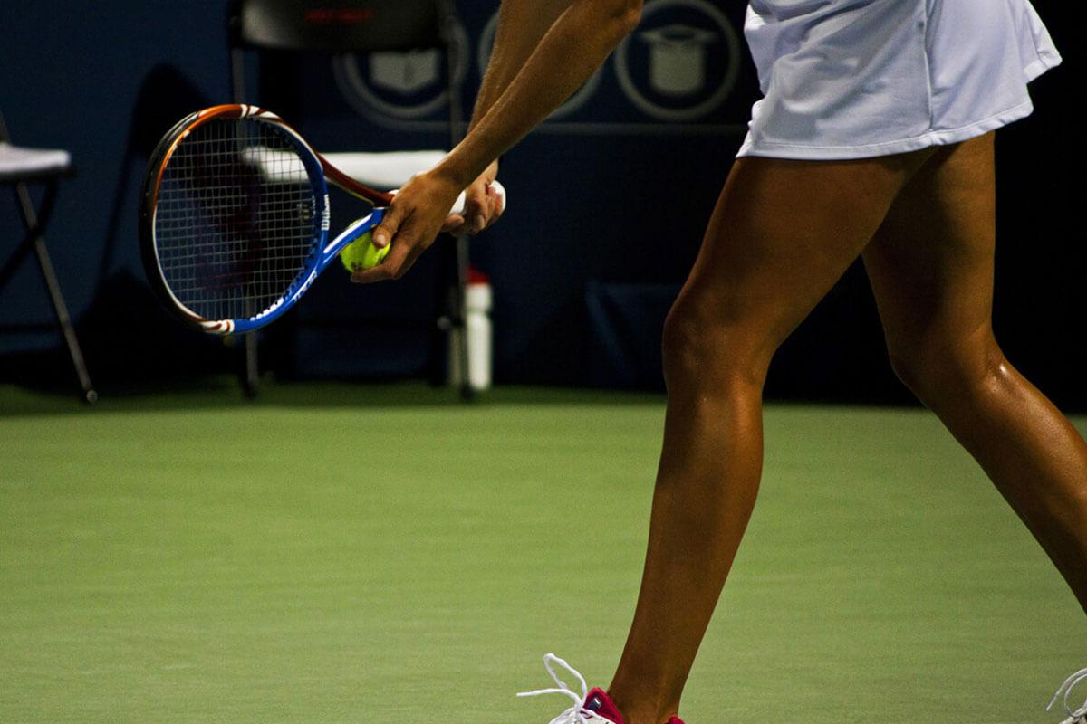 a woman holding a racket on a court