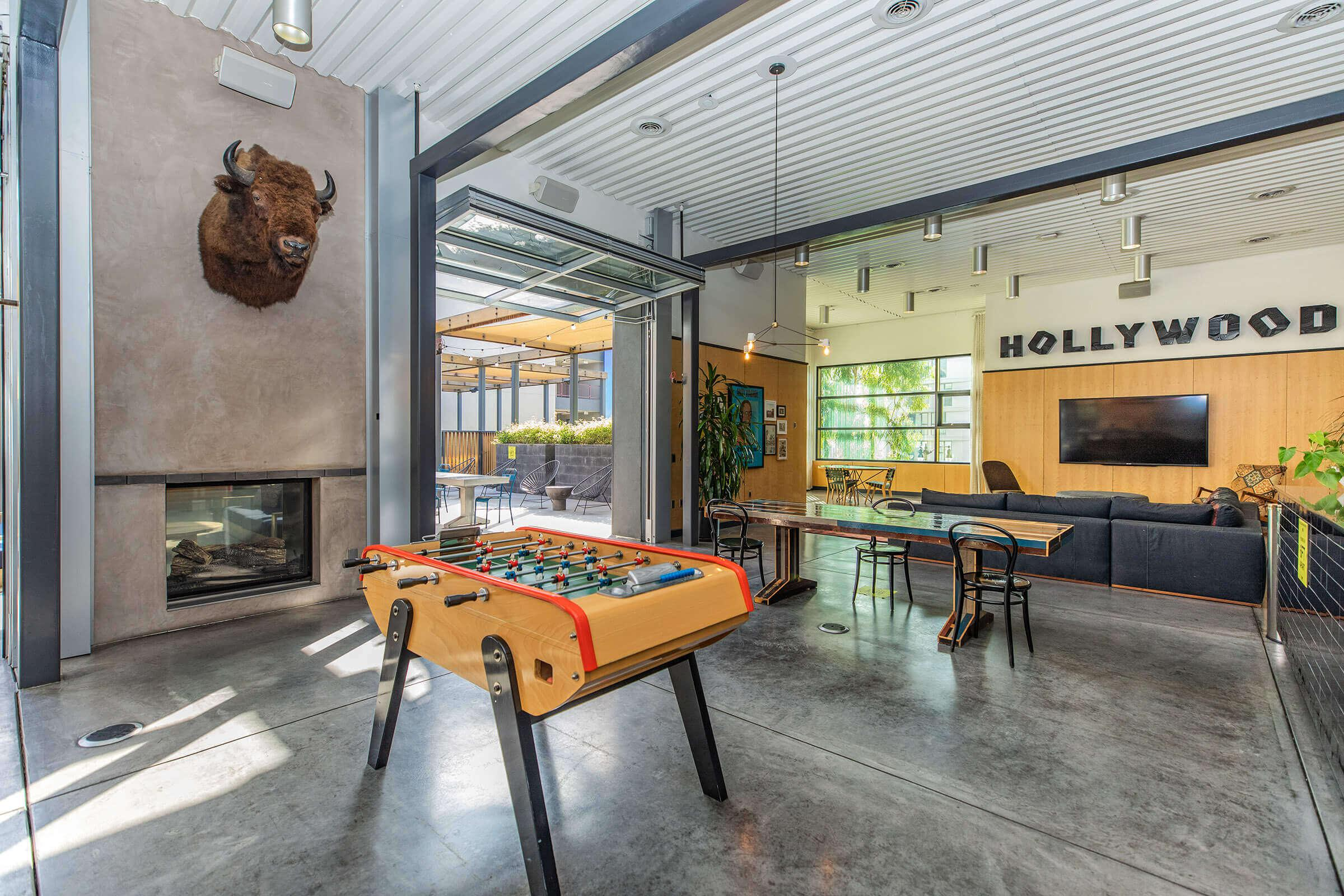 Eastown Apartments community room with a foosball table