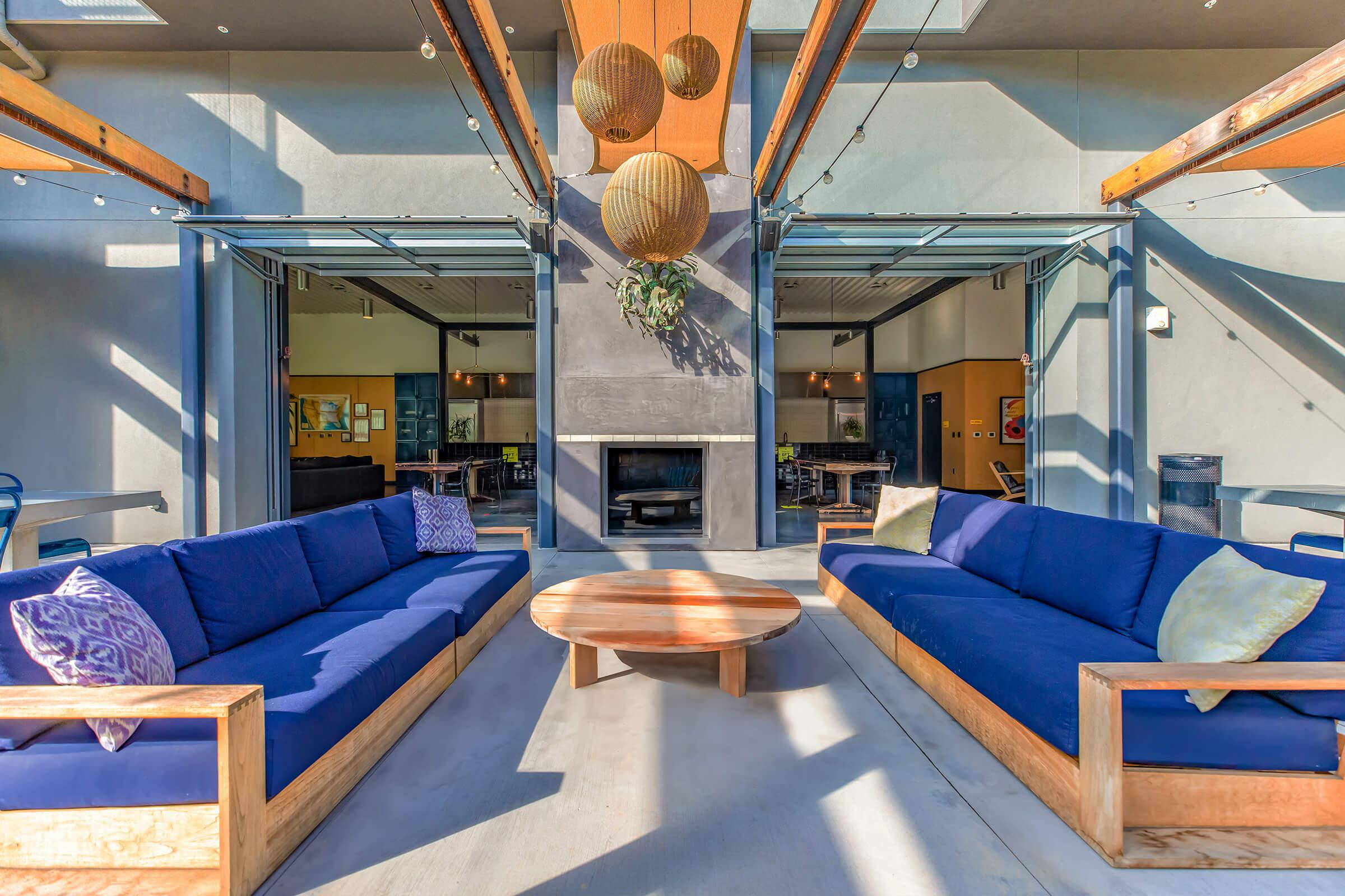 Outdoor seating area with blue couches