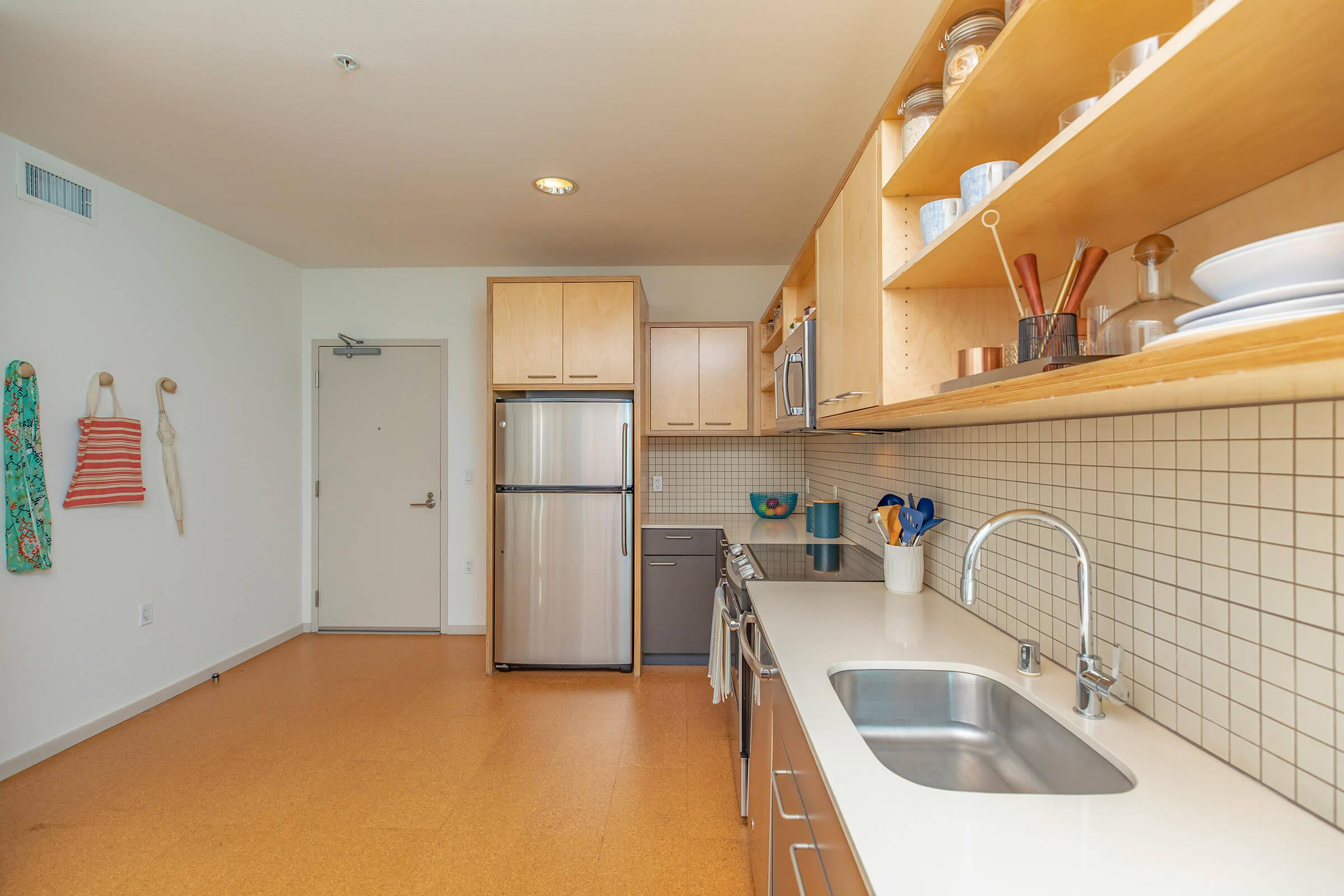 a kitchen with a sink and a counter in a room