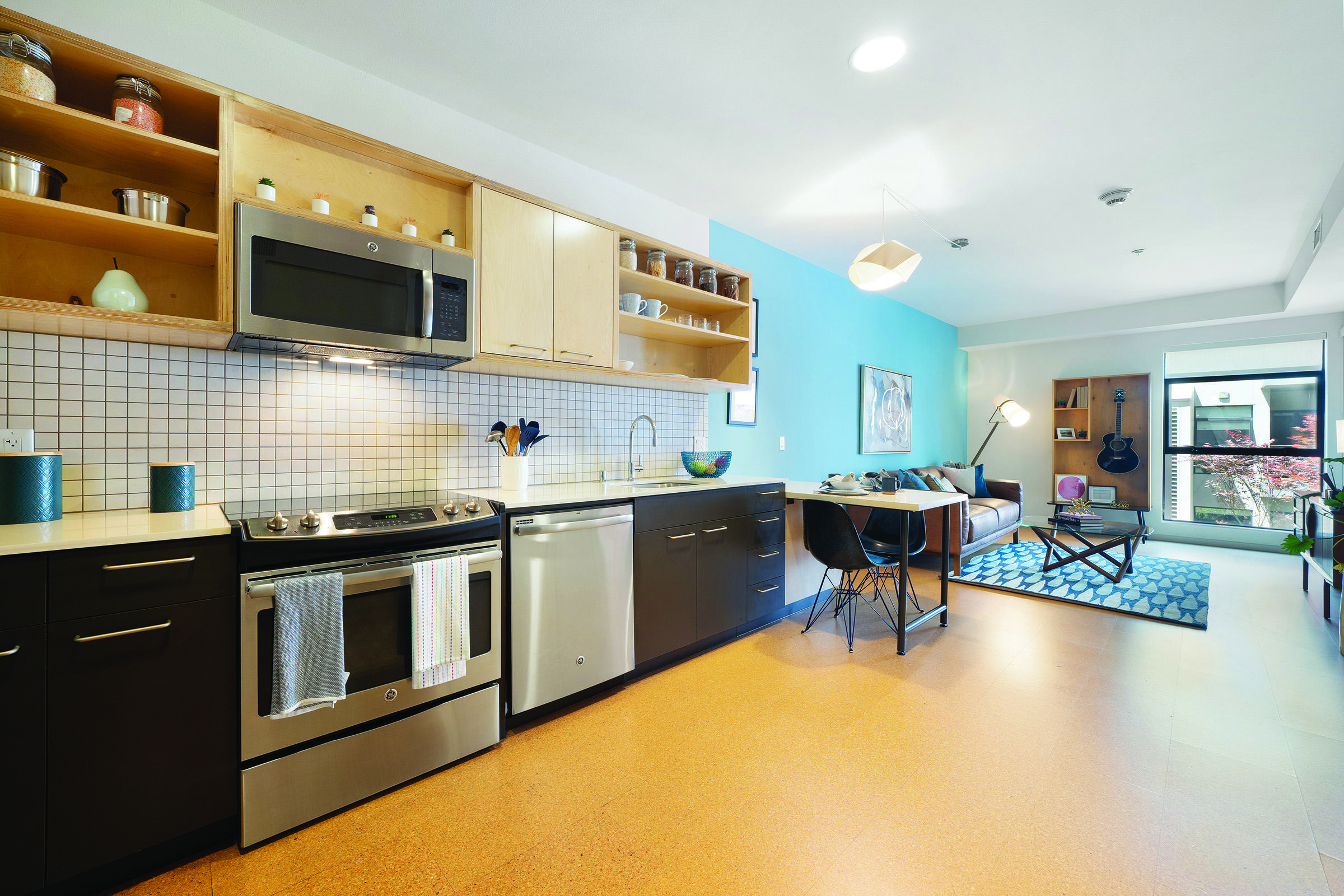 a room filled with furniture and a counter in a kitchen