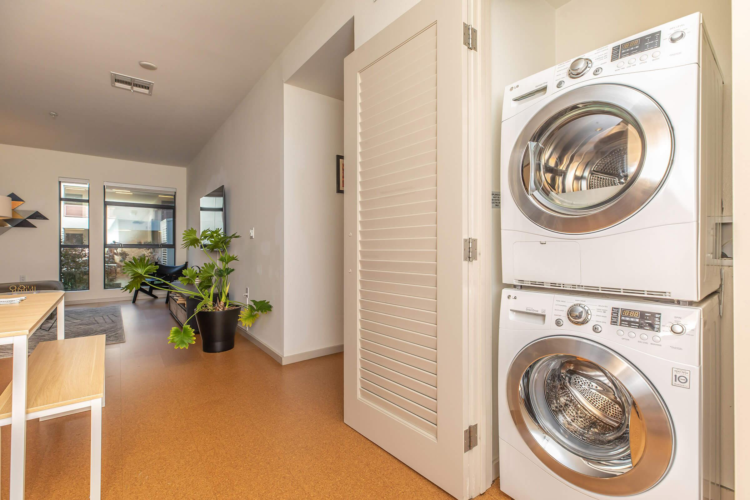 Washer and dryer across from kitchen
