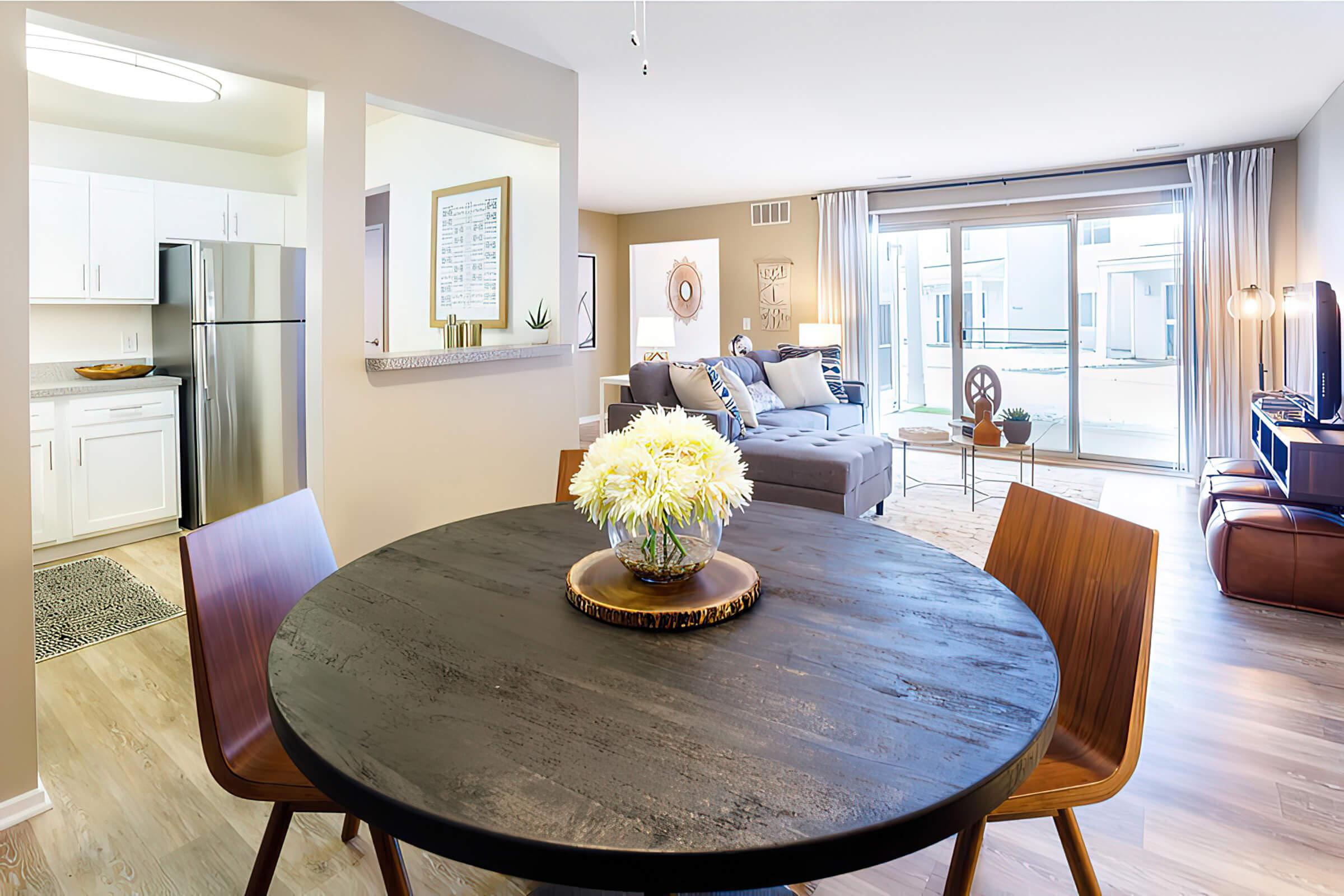 a living room filled with furniture and vase on a table