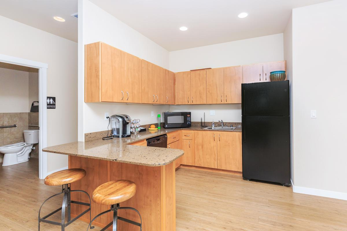 a kitchen with stainless steel appliances and wooden cabinets