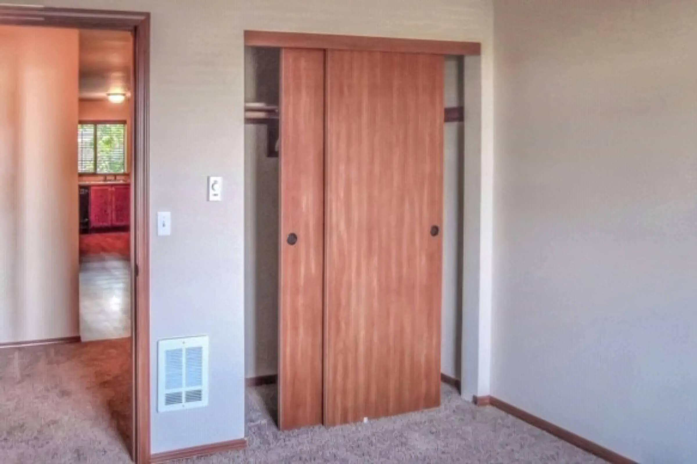 a wooden door in a room