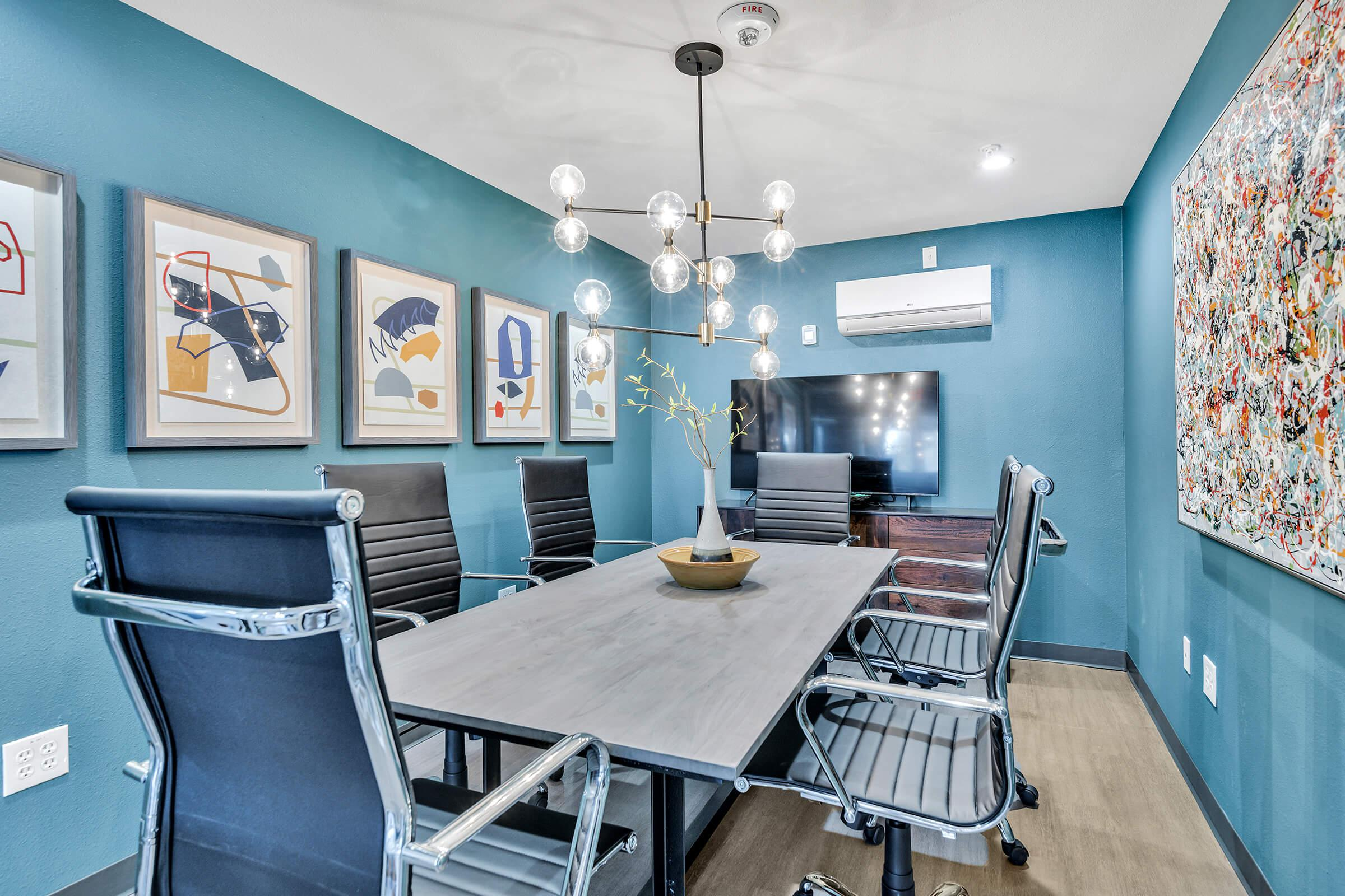 a table topped with a blue chair in a room