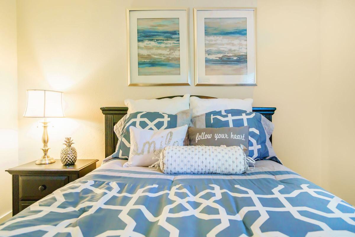 a blue and white bed in a room