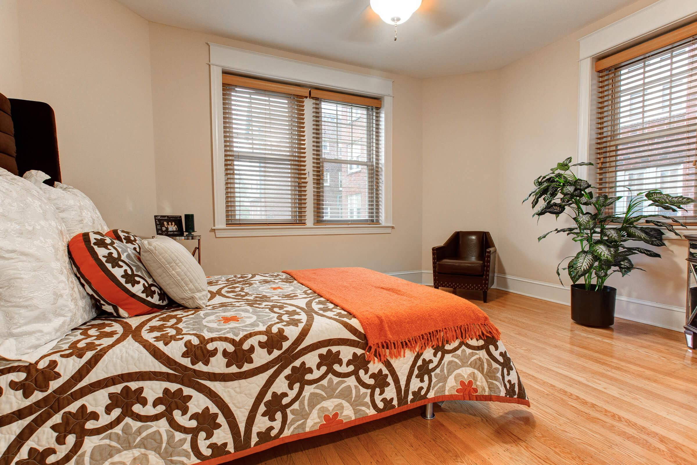 a living room with a bed and a window