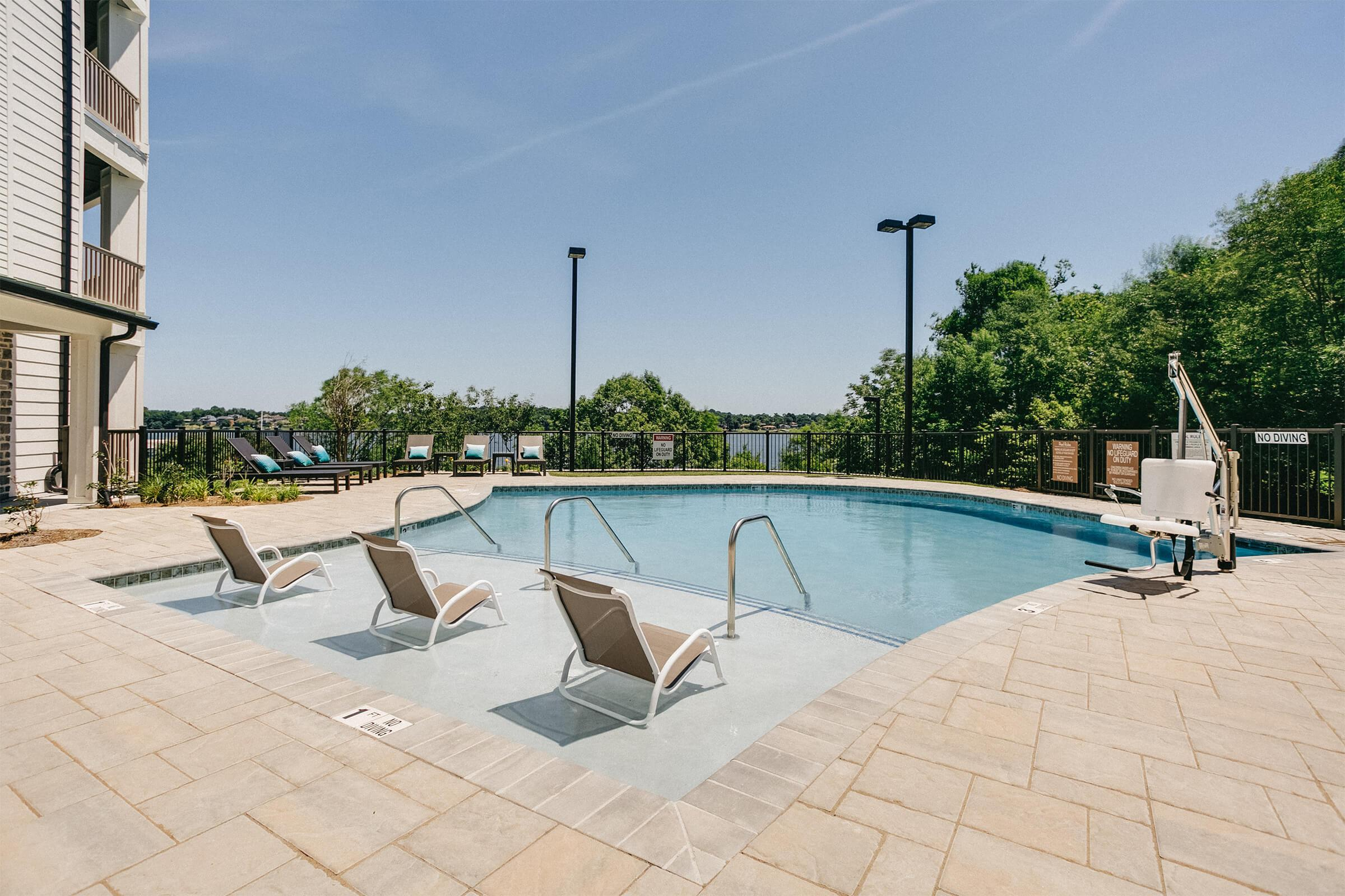 Enjoy the shimmering swimming pool at The Residence at Old Hickory Lake