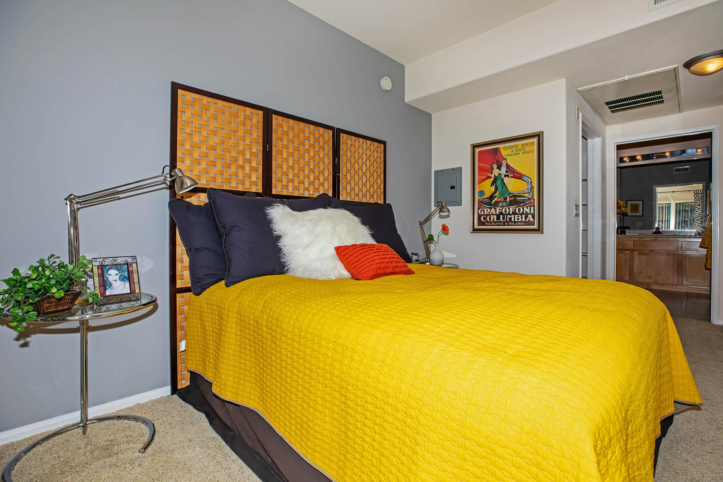a yellow bed in a room