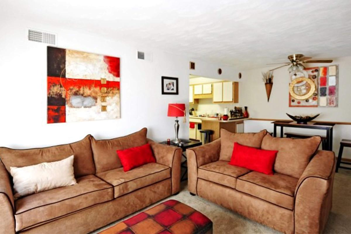 a red leather couch in a living room