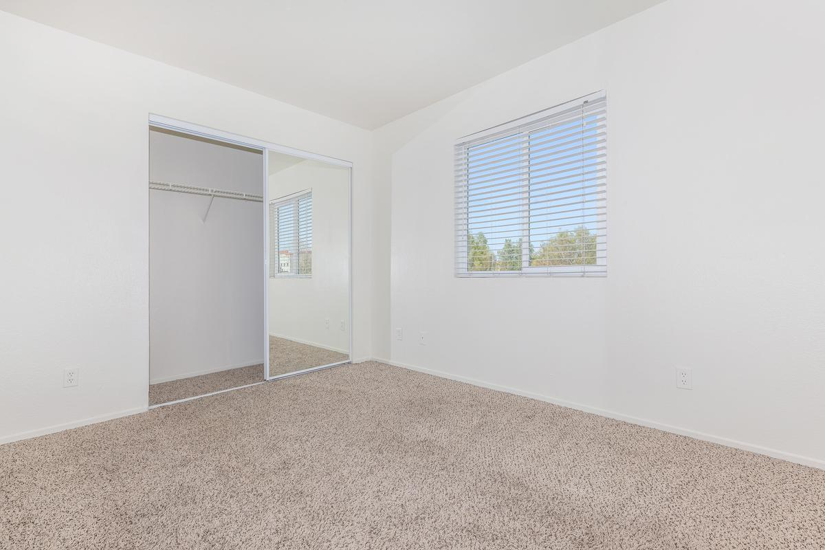 Walk-in closets are available at Las Brisas De Cheyenne Apartments