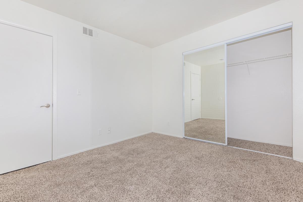 COMFORTABLE BEDROOM AT LAS BRISAS DE CHEYENNE APARTMENTS IN LAS VEGAS, NEVADA